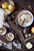 Apple crumble with almonds on rustic table with wood frames, whole apples and cloth — Stock Photo