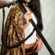 Hunting rifle, a girl with a gun — Stock Photo #52655917