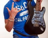 Guitar, electric guitar, a man holding a guitar in his hands — Foto de Stock