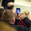 Постер, плакат: Man photographs the phone lecture