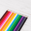 Colour pencils on wooden background — Stock Photo #60905667