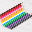 Colour pencils on wooden background — Stock Photo #60905677
