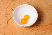 Yellow egg yolks in a white bowl — Foto de Stock