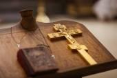 Golden christian cross on table — Stock Photo