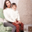 Little boy with mom posing in Christmas interior — Stock Photo #61959293