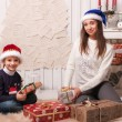 Little boy with mom posing in Christmas interior — Stock Photo #61959375