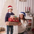 Little boy with mom posing in Christmas interior — Stock Photo #61959391