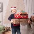 Little boy with mom posing in Christmas interior — Stock Photo #61959419