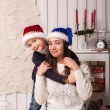 Little boy with mom posing in Christmas interior — Stock Photo #61959433