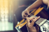 Hand of man in classical guitar — Stock Photo