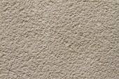 Closeup of bright-yellow plaster wall — Stock Photo