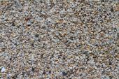 Colorful and white pebbles in different shapes and sizes — Stockfoto