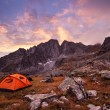 Tourist camping in the mountains — Stock Photo #53675799