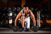 Man doing workout with barbell — Stock Photo