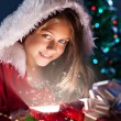 Girl open christmas box — Stock Photo #54546801