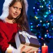 Happy Little Girl Holding a Present Christmas Box — Stock Photo #58259755