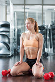 Woman in the gym with barbell — Stock Photo