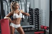 Young sexy woman in the gym — Zdjęcie stockowe