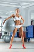 Sportive woman with ball in the gym — Stockfoto