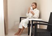 Woman enjoying a cup of coffee — Stock Photo