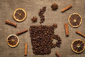 Coffee mug made from coffee beans on burlab texture — Stock Photo