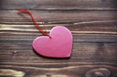 Love heart on wooden texture background, valentines day card concept — Stock Photo
