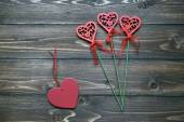 Heart shaped wooden flowers and red wooden heart. Symbols of Love Valentine's day — Foto de Stock