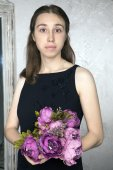 Portrait of a young Caucasian woman with purple flowers — 图库照片