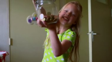 Girl holding coins jar — Stock Video