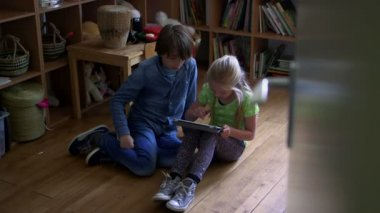 Boy and girl using a tablet — Stock Video