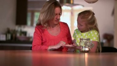 Girl holding coins — Stock Video