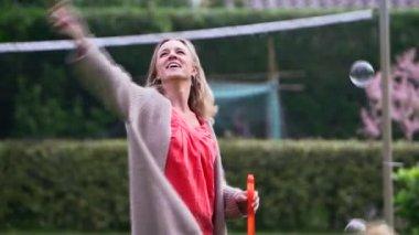 Woman holding bubble wand — Stock Video