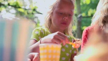 Girl eating cake — Stock Video