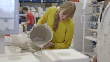 Ceramic designer pouring clay into mold — Stock Video