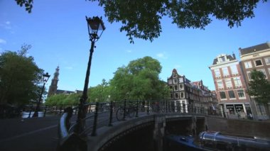 Pedestrian near bridge across canal — Stock Video