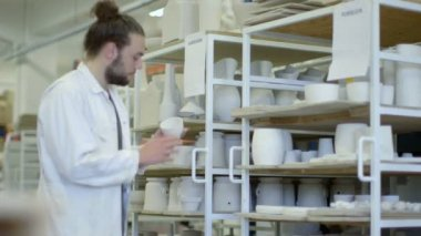 Male potter checking ceramic product — Stock Video