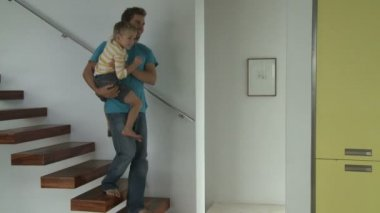 Man carring son to kitchen — Stock Video