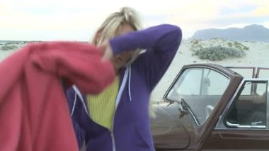 Young woman next to a car — Stockvideo