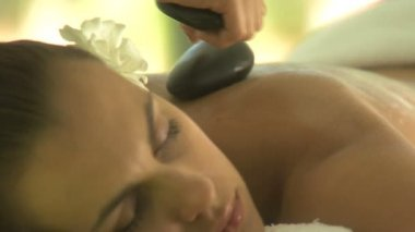 Woman having stone therapy — Stock Video
