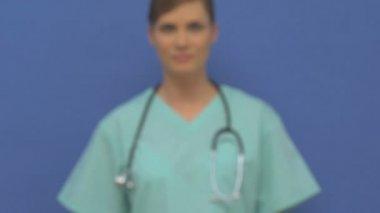 Female doctor walking towards camera — Stock Video