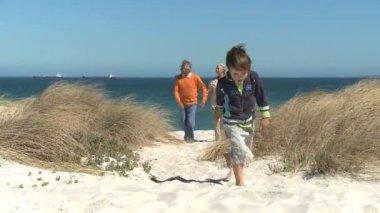 Grandson running on the beach — Stock Video