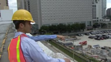 Construction workers inspecting a site — Stock Video