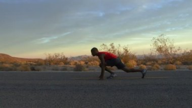 Male running along road — ストックビデオ