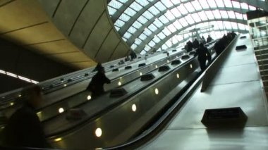 Commuters on escalators in London — Stock Video