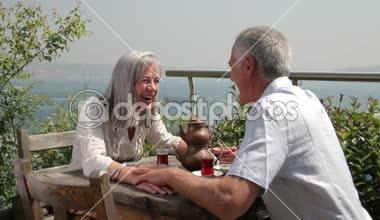 Couple drinking tea on terrace — Stock Video