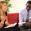 Businessman and female taking notes — Stock Video #67033659