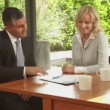 Female with financial advisor with laptop — Stock Video #67038185