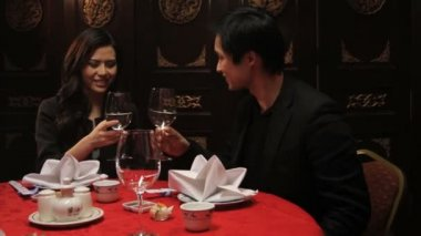 Couple toasting in restaurant — Stock Video