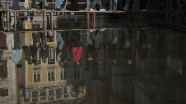 Pedestrians walking over bridge — Stock Video