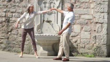 Senior couple dancing on romantic holiday — Stock Video